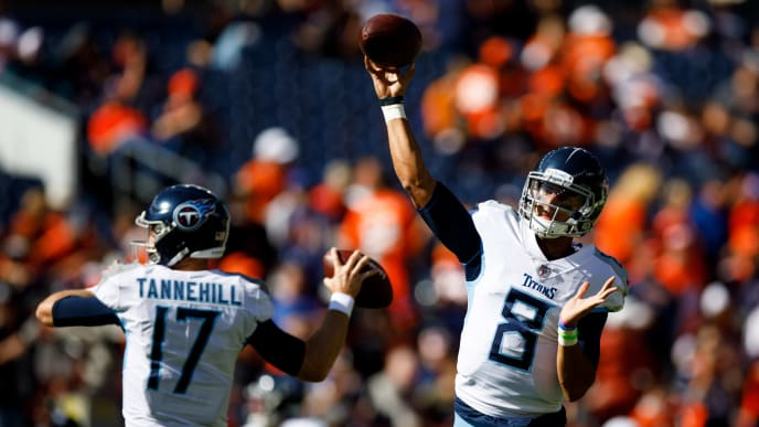 DENVER, CO - OCTOBER 13:  Quarterback Marcus Mariota #8 of the Tennessee Titans and quarterback Ryan Tannehill #17 of the Tennessee Titans warm up before a game against the Denver Broncos at Empower Field at Mile High on October 13, 2019 in Denver, Colorado. (Photo by Justin Edmonds/Getty Images)