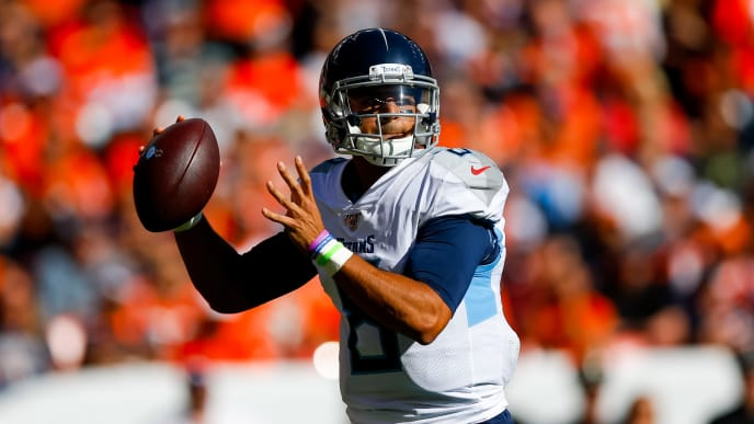 DENVER, CO - OCTOBER 13:  Quarterback Marcus Mariota #8 of the Tennessee Titans throws a pass during the second quarter against the Denver Broncos at Empower Field at Mile High on October 13, 2019 in Denver, Colorado. (Photo by Justin Edmonds/Getty Images)