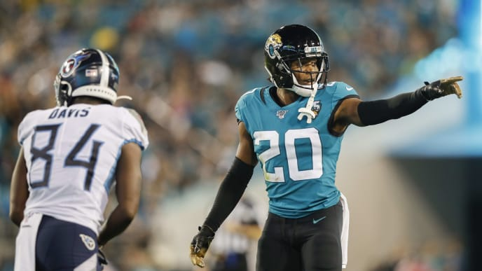 JACKSONVILLE, FLORIDA - SEPTEMBER 19: Jalen Ramsey #20 of the Jacksonville Jaguars defends against Corey Davis #84 of the Tennessee Titans during the third quarter of a game at TIAA Bank Field on September 19, 2019 in Jacksonville, Florida. (Photo by James Gilbert/Getty Images)