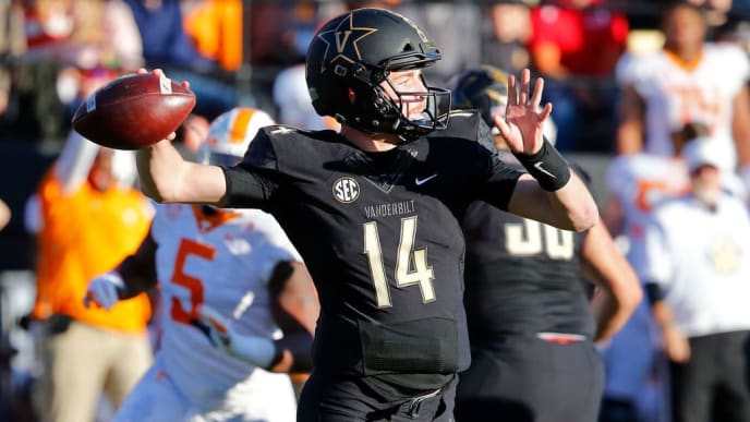 NASHVILLE, TN - NOVEMBER 24:  Quarterback Kyle Shurmur #14 of the Vanderbilt Commodores drops back to throw a pass against the Tennessee Volunteers during the first half at Vanderbilt Stadium on November 24, 2018 in Nashville, Tennessee.  (Photo by Frederick Breedon/Getty Images)