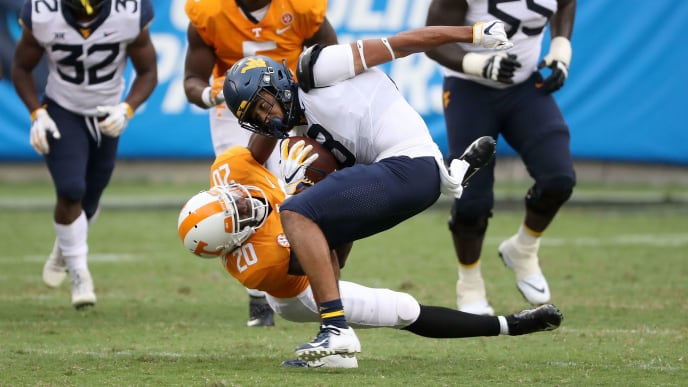 CHARLOTTE, NC - SEPTEMBER 01:  Bryce Thompson #20 of the Tennessee Volunteers tries to tackle Marcus Simms #8 of the West Virginia Mountaineers during their game at Bank of America Stadium on September 1, 2018 in Charlotte, North Carolina.  (Photo by Streeter Lecka/Getty Images)