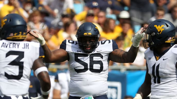 CHARLOTTE, NC - SEPTEMBER 01:  Darius Stills #56 of the West Virginia Mountaineers reacts after a play against the Tennessee Volunteers during their game at Bank of America Stadium on September 1, 2018 in Charlotte, North Carolina.  (Photo by Streeter Lecka/Getty Images)