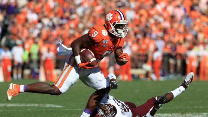 CLEMSON, SOUTH CAROLINA - SEPTEMBER 07: Roney Elam #27 of the Texas A&M Aggies tries to stop Travis Etienne #9 of the Clemson Tigers during their game at Memorial Stadium on September 07, 2019 in Clemson, South Carolina. (Photo by Streeter Lecka/Getty Images)