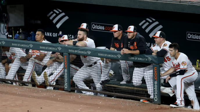 BALTIMORE, MARYLAND - SEPTEMBER 05: Members of the Baltimore Orioles look on during the ninth inning of their 3-1 loss to the Texas Rangers at Oriole Park at Camden Yards on September 05, 2019 in Baltimore, Maryland. (Photo by Rob Carr/Getty Images)