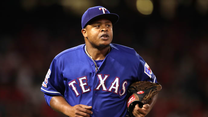 ANAHEIM, CALIFORNIA - APRIL 04:  Edinson Volquez #36 of the Texas Rangers is taken out of the game and leaves the mound during the fourth inning against the Los Angeles Angels of Anaheim in the home opener at Angel Stadium of Anaheim on April 04, 2019 in Anaheim, California. (Photo by Sean M. Haffey/Getty Images)