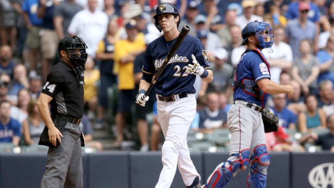 MILWAUKEE, WISCONSIN - AUGUST 11:  Christian Yelich #22 of the Milwaukee Brewers walks back to the dugout after striking out in the eighth inning against the Texas Rangers at Miller Park on August 11, 2019 in Milwaukee, Wisconsin. (Photo by Dylan Buell/Getty Images)