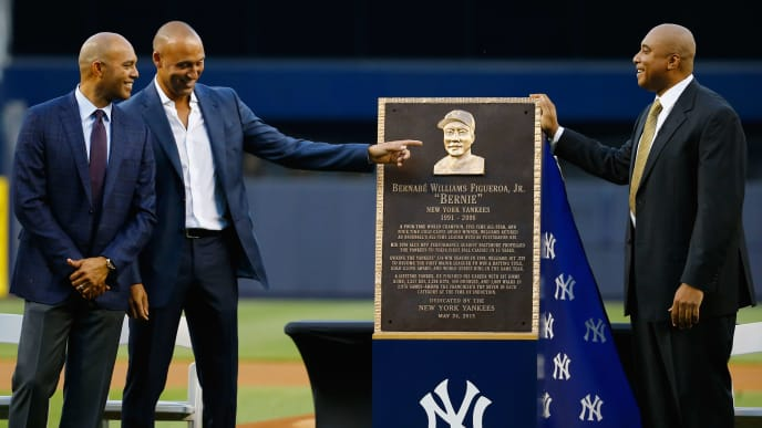 NEW YORK, NY - MAY 24:  Derek Jeter and Mariano Rivera speak to Bernie Williams during the ceremony to retire his number in Monument Park before the game against the Texas Rangers at Yankee Stadium on May 24, 2015 in New York City.  (Photo by Al Bello/Getty Images)