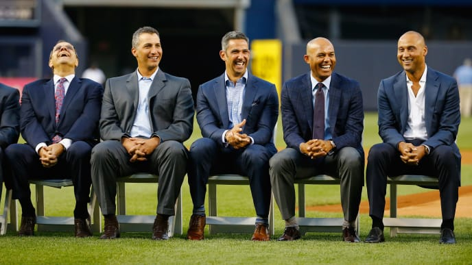 NEW YORK, NY - MAY 24:  Joe Torre, Andy Pettitte, Jorge Posada, Mariano Rivera and Derek Jeter laugh during the ceremony to retire  Bernie Williams number in Monument Park before the game against the Texas Rangers at Yankee Stadium on May 24, 2015 in New York City.  (Photo by Al Bello/Getty Images)