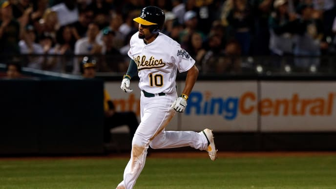 OAKLAND, CA - SEPTEMBER 21:  Marcus Semien #10 of the Oakland Athletics rounds the bases after hitting a home run against the Texas Rangers during the fifth inning at the RingCentral Coliseum on September 21, 2019 in Oakland, California. The Oakland Athletics defeated the Texas Rangers 12-3. (Photo by Jason O. Watson/Getty Images)
