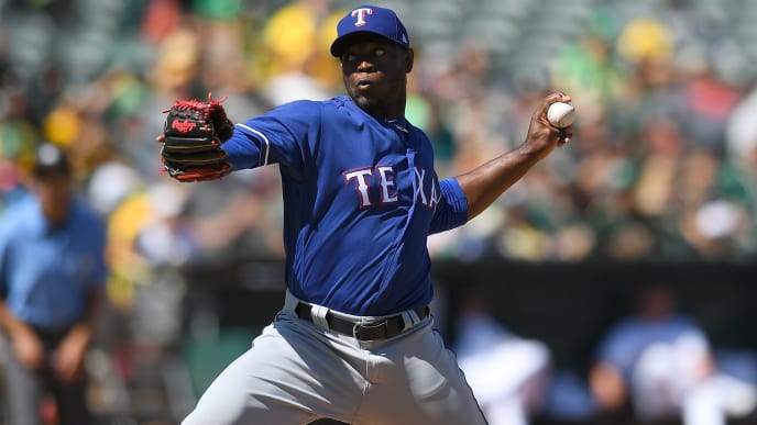 OAKLAND, CA - SEPTEMBER 09:  C.D. Pelham #64 of the Texas Rangers pitches against the Oakland Athletics in the bottom of the fourth inning at Oakland Alameda Coliseum on September 9, 2018 in Oakland, California.  (Photo by Thearon W. Henderson/Getty Images)