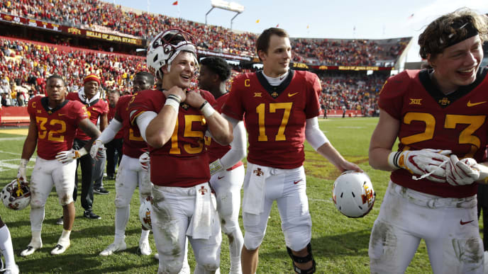 AMES, IA - OCTOBER 27: Quarterback Brock Purdy #15 of the Iowa State Cyclones celebrates with teammates quarterback Kyle Kempt #17, and linebacker Mike Rose #23 of the Iowa State Cyclones after defeating the Texas Tech Red Raiders 40-31 at Jack Trice Stadium on October 27, 2018 in Ames, Iowa. The Iowa State Cyclones won 40-31 over the Texas Tech Red Raiders. (Photo by David Purdy/Getty Images)