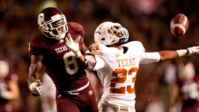 COLLEGE STATION, TX - NOVEMBER 24:  Carrington Byndom #23 of the Texas Longhorns breaks up a  pass intended for Jeff Fuller #8 of the Texas A&M Aggies in the first half of a game at Kyle Field on November 24, 2011 in College Station, Texas. (Photo by Darren Carroll/Getty Images)