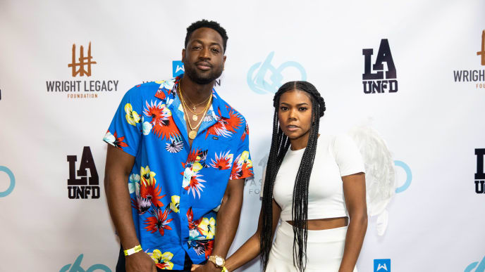 LOS ANGELES, CALIFORNIA - AUGUST 03: Dwyane Wade (L) and Gabrielle Union (R) pose together at the Wright Legacy Foundation skate night at World on Wheels on August 03, 2019 in Los Angeles, California. (Photo by Cassy Athena/Getty Images)