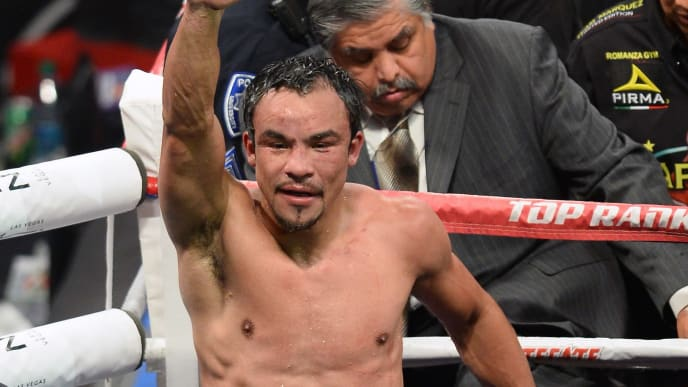 LAS VEGAS, NV - OCTOBER 12:  Juan Manuel Marquez raises his arm as he leaves the ring after his fight against WBO welterweight champion Timothy Bradley Jr. at the Thomas & Mack Center on October 12, 2013 in Las Vegas, Nevada. Bradley won in a split decision.  (Photo by Ethan Miller/Getty Images)