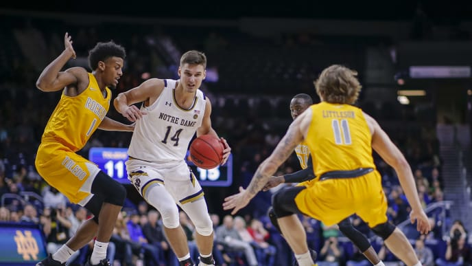 SOUTH BEND, IN - NOVEMBER 21: Nate Laszewski #14 of the Notre Dame Fighting Irish drives to the basket during the game against the Toledo Rockets at Purcell Pavilion on November 21, 2019 in South Bend, Indiana. (Photo by Michael Hickey/Getty Images)
