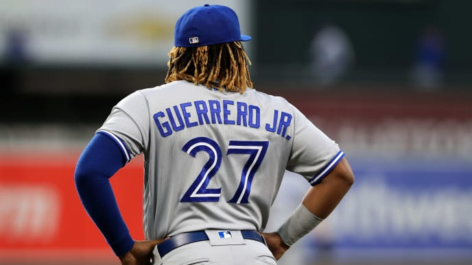 BALTIMORE, MARYLAND - SEPTEMBER 19: Vladimir Guerrero Jr. #27 of the Toronto Blue Jays warms up against the Baltimore Orioles at Oriole Park at Camden Yards on September 19, 2019 in Baltimore, Maryland. (Photo by Rob Carr/Getty Images)