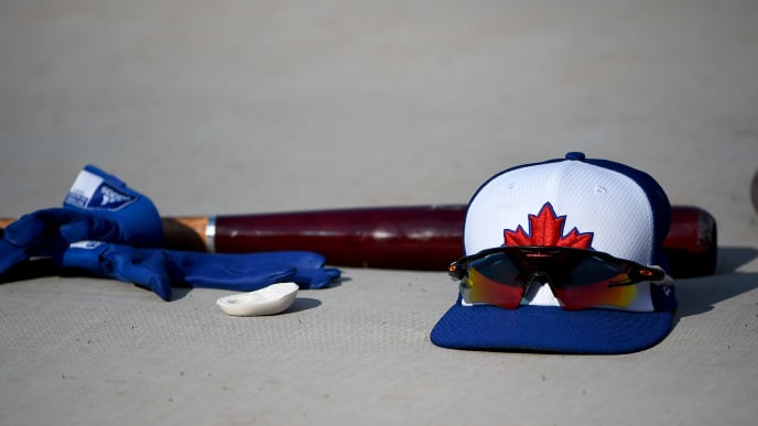 BALTIMORE, MD - AUGUST 02: A detailed view of a Toronto Blue Jays hat and Oakley sunglasses prior to the game between the Baltimore Orioles and the Toronto Blue Jays at Oriole Park at Camden Yards on August 2, 2019 in Baltimore, Maryland. (Photo by Will Newton/Getty Images)