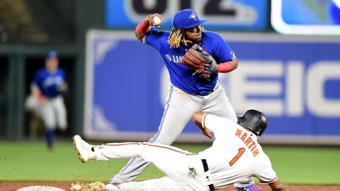 BALTIMORE, MD - AUGUST 01: Vladimir Guerrero Jr. #27 of the Toronto Blue Jays forces out Richie Martin #1 of the Baltimore Orioles to start a double play in the ninth inning at Oriole Park at Camden Yards on August 1, 2019 in Baltimore, Maryland.  (Photo by Greg Fiume/Getty Images)