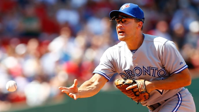BOSTON, MA - JULY 22: Omar Vizquel #17 of the Toronto Blue Jays flips the ball to first base for an out against the Boston Red Sox during the game on July 22, 2012 at Fenway Park in Boston, Massachusetts.  (Photo by Jared Wickerham/Getty Images)