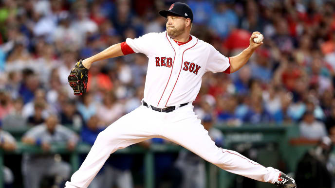 BOSTON, MA - JULY 18:  Brian Johnson #61 of the Boston Red Sox pitches against the Toronto Blue Jays during the first inning at Fenway Park on July 18, 2017 in Boston, Massachusetts. (Photo by Maddie Meyer/Getty Images)