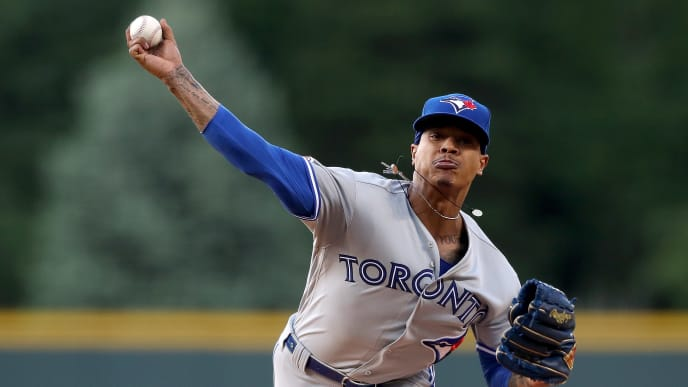 DENVER, COLORADO - JUNE 01: Starting pitcher Marcus Stroman #6 of the Toronto Blue Jays throws in the first inning against the Colorado Rockies at Coors Field on June 01, 2019 in Denver, Colorado. (Photo by Matthew Stockman/Getty Images)