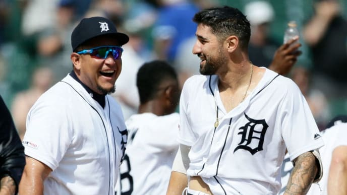 DETROIT, MI - JULY 21:  Miguel Cabrera #24 of the Detroit Tigers laughs after Nicholas Castellanos #9 was drenched with water after hitting a walk off home run to beat the Toronto Blue Jays 4-3 in 10 innings at Comerica Park on July 21, 2019 in Detroit, Michigan. (Photo by Duane Burleson/Getty Images)
