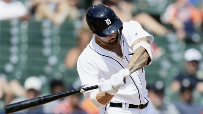 DETROIT, MI - JULY 21:  Nicholas Castellanos #9 of the Detroit Tigers swings on his solo home run to defeat the Toronto Blue Jays 4-3 in the 10th inning at Comerica Park on July 21, 2019 in Detroit, Michigan. (Photo by Duane Burleson/Getty Images)