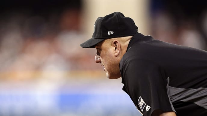 HOUSTON, TEXAS - JUNE 14: Umpire Eric Cooper looks in from first base at Minute Maid Park on June 14, 2019 in Houston, Texas. (Photo by Bob Levey/Getty Images)