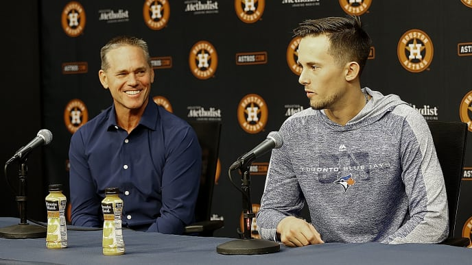 HOUSTON, TEXAS - JUNE 14: Cavan Biggio of the Toronto Blue Jays answers questions from the media as his father Craig Biggio looks on about his emotions are playing in the major leagues and playing this weekend where is hall of famer father Craig Biggio played for so many years at Minute Maid Park on June 14, 2019 in Houston, Texas. (Photo by Bob Levey/Getty Images)