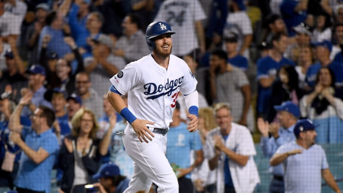 LOS ANGELES, CALIFORNIA - AUGUST 22:  Cody Bellinger #35 of the Los Angeles Dodgers reacts after his run from a Corey Seager #5 double, to tie the game 2-2 with the Toronto Blue Jays, during the ninth inning at Dodger Stadium on August 22, 2019 in Los Angeles, California. (Photo by Harry How/Getty Images)