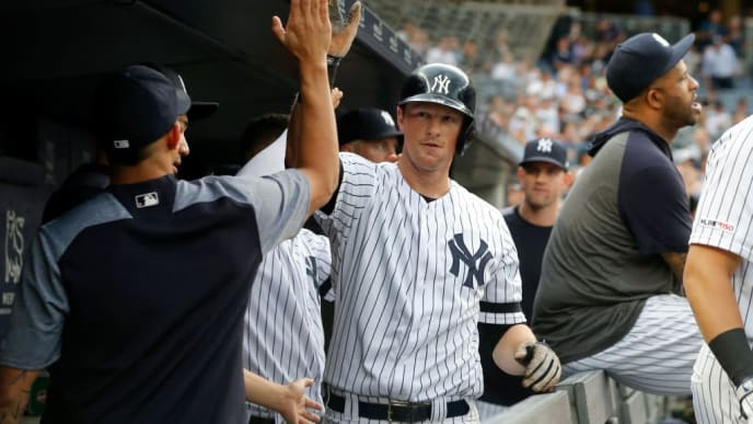 NEW YORK, NEW YORK - JUNE 25: DJ LeMahieu #26 of the New York Yankees celebrates his first inning home run against the Toronto Blue Jays with his teammates in the dugout at Yankee Stadium on June 25, 2019 in the Bronx borough of New York City. (Photo by Jim McIsaac/Getty Images)