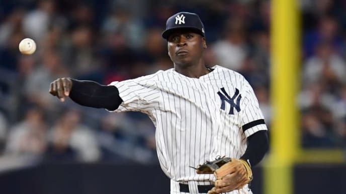 NEW YORK, NEW YORK - SEPTEMBER 20: Didi Gregorius #18 of the New York Yankees throws the ball to first base during the fifth inning of their game against the Toronto Blue Jays at Yankee Stadium on September 20, 2019 in the Bronx borough of New York City. (Photo by Emilee Chinn/Getty Images)