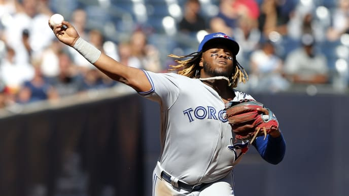 NEW YORK, NEW YORK - SEPTEMBER 21:   Vladimir Guerrero Jr. #27 of the Toronto Blue Jays in action against the New York Yankees at Yankee Stadium on September 21, 2019 in New York City. The Yankees defeated the Blue Jays 7-2. (Photo by Jim McIsaac/Getty Images)