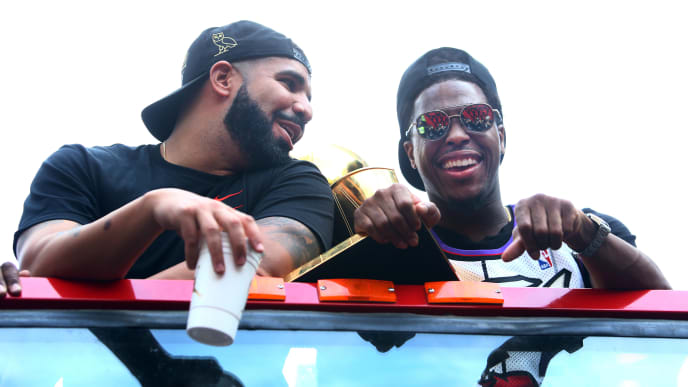 TORONTO, ON - JUNE 17:  Drake and Kyle Lowry #7 of the Toronto Raptors holds the championship trophy during the Toronto Raptors Victory Parade on June 17, 2019 in Toronto, Canada. The Toronto Raptors beat the Golden State Warriors 4-2 to win the 2019 NBA Finals.  NOTE TO USER: User expressly acknowledges and agrees that, by downloading and or using this photograph, User is consenting to the terms and conditions of the Getty Images License Agreement.  (Photo by Vaughn Ridley/Getty Images)