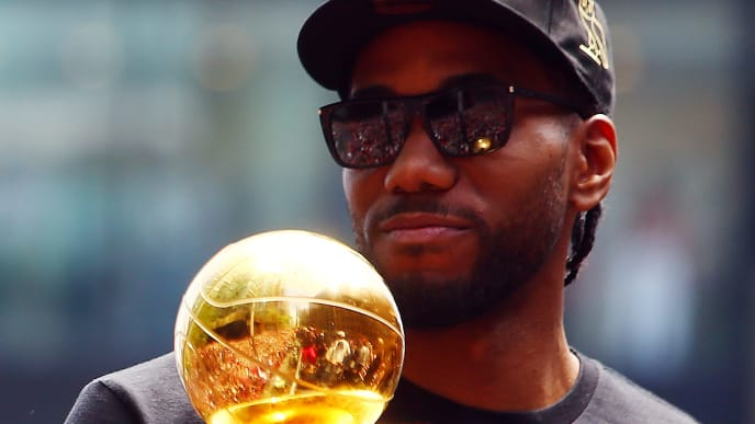 TORONTO, ON - JUNE 17:  Kawhi Leonard #2 of the Toronto Raptors holds the MVP trophy during the Toronto Raptors Victory Parade on June 17, 2019 in Toronto, Canada. The Toronto Raptors beat the Golden State Warriors 4-2 to win the 2019 NBA Finals.  NOTE TO USER: User expressly acknowledges and agrees that, by downloading and or using this photograph, User is consenting to the terms and conditions of the Getty Images License Agreement.  (Photo by Vaughn Ridley/Getty Images)