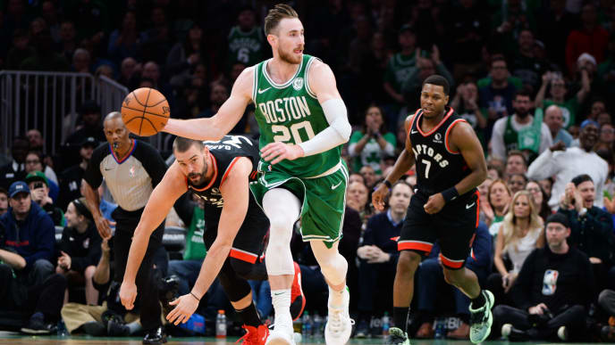 BOSTON, MA - OCTOBER 25: Gordon Hayward #20 of the Boston Celtics dribbles the ball past Marc Gasol #33 and Kyle Lowry #7 of the Toronto Raptors in the second half at TD Garden on October 25, 2019 in Boston, Massachusetts. NOTE TO USER: User expressly acknowledges and agrees that, by downloading and or using this photograph, User is consenting to the terms and conditions of the Getty Images License Agreement. (Photo by Kathryn Riley/Getty Images)