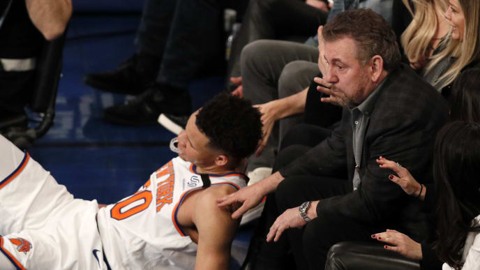 NEW YORK, NY - MARCH 28:  New York Knicks owner James Dolan reacts to Kevin Knox #20 of the Knicks falling at his feet as he watches an NBA basketball game against the Toronto Raptors from his front row seat on March 28, 2019 at Madison Square Garden Center in New York City. Raptors won 117-92. NOTE TO USER: User expressly acknowledges and agrees that, by downloading and/or using this Photograph, user is consenting to the terms and conditions of the Getty License agreement. Mandatory Copyright Notice (Photo by Paul Bereswill/Getty Images)