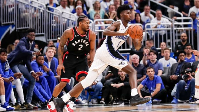 ORLANDO, FL - APRIL 19: Jonathan Isaac #1 of the Orlando Magic passes the ball off as he is defended by Kawhi Leonard #2 of the Toronto Raptors during Game Three of the first round of the 2019 NBA Eastern Conference Playoffs at the Amway Center on April 19, 2019 in Orlando, Florida. The Raptors defeated the Magic 98 to 93. NOTE TO USER: User expressly acknowledges and agrees that, by downloading and or using this photograph, User is consenting to the terms and conditions of the Getty Images License Agreement. (Photo by Don Juan Moore/Getty Images)