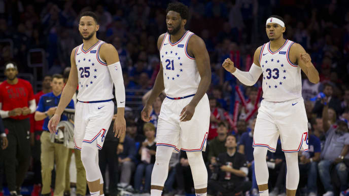 PHILADELPHIA, PA - MAY 05: Ben Simmons #25, Joel Embiid #21, and Tobias Harris #33 of the Philadelphia 76ers react against the Toronto Raptors in Game Four of the Eastern Conference Semifinals at the Wells Fargo Center on May 5, 2019 in Philadelphia, Pennsylvania. The Raptors defeated the 76ers 101-96. NOTE TO USER: User expressly acknowledges and agrees that, by downloading and or using this photograph, User is consenting to the terms and conditions of the Getty Images License Agreement. (Photo by Mitchell Leff/Getty Images)