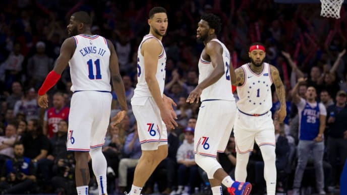 PHILADELPHIA, PA - MAY 09: James Ennis III #11, Ben Simmons #25, Joel Embiid #21, and Mike Scott #1 of the Philadelphia 76ers in action against the Toronto Raptors in Game Six of the Eastern Conference Semifinals at the Wells Fargo Center on May 9, 2019 in Philadelphia, Pennsylvania. The 76ers defeated the Raptors 112-101. NOTE TO USER: User expressly acknowledges and agrees that, by downloading and or using this photograph, User is consenting to the terms and conditions of the Getty Images License Agreement. (Photo by Mitchell Leff/Getty Images)