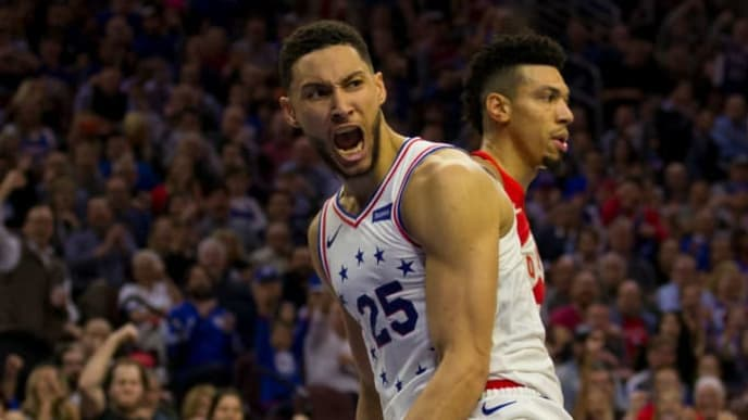 PHILADELPHIA, PA - MAY 09: Ben Simmons #25 of the Philadelphia 76ers reacts in front of Danny Green #14 of the Toronto Raptors after dunking the ball in the third quarter of Game Six of the Eastern Conference Semifinals at the Wells Fargo Center on May 9, 2019 in Philadelphia, Pennsylvania. The 76ers defeated the Raptors 112-101. NOTE TO USER: User expressly acknowledges and agrees that, by downloading and or using this photograph, User is consenting to the terms and conditions of the Getty Images License Agreement. (Photo by Mitchell Leff/Getty Images)