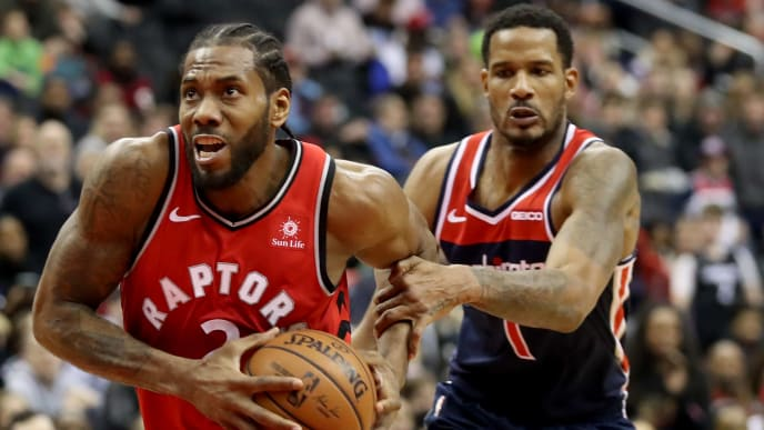 WASHINGTON, DC - JANUARY 13: Trevor Ariza #1 of the Washington Wizards fouls Kawhi Leonard #2 of the Toronto Raptors in double overtime at Capital One Arena on January 13, 2019 in Washington, DC. NOTE TO USER: User expressly acknowledges and agrees that, by downloading and or using this photograph, User is consenting to the terms and conditions of the Getty Images License Agreement. (Photo by Rob Carr/Getty Images)