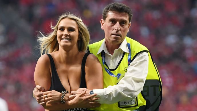 MADRID, SPAIN - JUNE 01: Pitch invader Kinsey Wolanski is taken off the pitch after running on during the UEFA Champions League Final between Tottenham Hotspur and Liverpool at Estadio Wanda Metropolitano on June 01, 2019 in Madrid, Spain. (Photo by Matthias Hangst/Getty Images)
