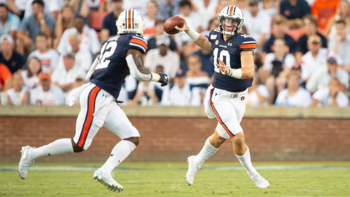 AUBURN, AL - SEPTEMBER 7: Quarterback Bo Nix #10 of the Auburn Tigers looks to throw the ball to wide receiver Eli Stove #12 of the Auburn Tigers during the first quarter of their game against the Tulane Green Wave at Jordan-Hare Stadium on September 7, 2019 in Auburn, Alabama. (Photo by Michael Chang/Getty Images)
