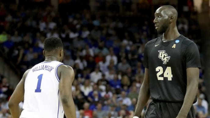 COLUMBIA, SOUTH CAROLINA - MARCH 24: Tacko Fall #24 of the UCF Knights and Zion Williamson #1 of the Duke Blue Devils look on during the first half in the second round game of the 2019 NCAA Men's Basketball Tournament at Colonial Life Arena on March 24, 2019 in Columbia, South Carolina. (Photo by Streeter Lecka/Getty Images)