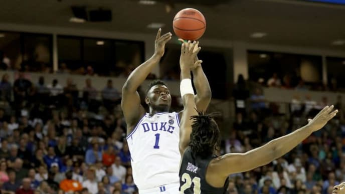 COLUMBIA, SOUTH CAROLINA - MARCH 24: Zion Williamson #1 of the Duke Blue Devils shoots the ball against Chad Brown #21 of the UCF Knights during the first half in the second round game of the 2019 NCAA Men's Basketball Tournament at Colonial Life Arena on March 24, 2019 in Columbia, South Carolina. (Photo by Streeter Lecka/Getty Images)