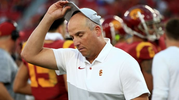 LOS ANGELES, CALIFORNIA - NOVEMBER 23:  Head coach Clay Helton of the USC Trojans looks on after defeating the UCLA Bruins 52-35 in a game at Los Angeles Memorial Coliseum on November 23, 2019 in Los Angeles, California. (Photo by Sean M. Haffey/Getty Images)
