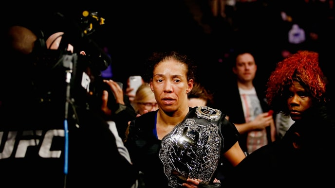 NEW YORK, NY - FEBRUARY 11:  Germaine de Randamie of The Netherlands exits the Octagon with the belt after defeating Holly Holm of United States in their UFC women's featherweight championship bout during UFC 208 at the Barclays Center on February 11, 2017 in the Brooklyn Borough of New York City.  (Photo by Anthony Geathers/Getty Images)