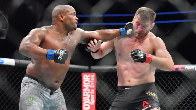 LAS VEGAS, NV - JULY 07:  Daniel Cormier (L) lands a punch against Stipe Miocic during their heavyweight championship fight at T-Mobile Arena on July 7, 2018 in Las Vegas, Nevada. Cormier won by first round knockout.  (Photo by Sam Wasson/Getty Images)