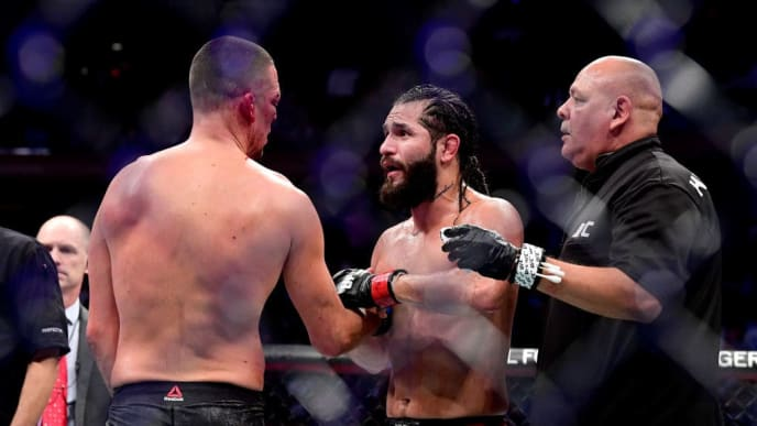 """NEW YORK, NEW YORK - NOVEMBER 02: Jorge Masvidal of the United States (R) speaks to Nate Diaz of the United States after he is awarded victory by TKO on a medical stoppage against in the Welterweight """"BMF"""" championship bout during UFC 244 at Madison Square Garden on November 02, 2019 in New York City. (Photo by Steven Ryan/Getty Images)"""